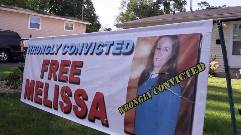 """Free Melissa Calusinski"" sign"
