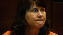 Los Angeles police detective Stephanie Lazarus is arraigned at the Criminal Justice Center in Los Angeles on murder charges, Tuesday, June 9, 2009. Lazarus, 49, is accused of killing Sherri Rasmussen, who was bitten, beaten and shot in her condominium in