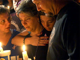 Diena Thompson, center, attends a candle-light vigil for her daughter Somer Thompson, Thursday, Oct. 22, 2009, in Orange Park, Fla.