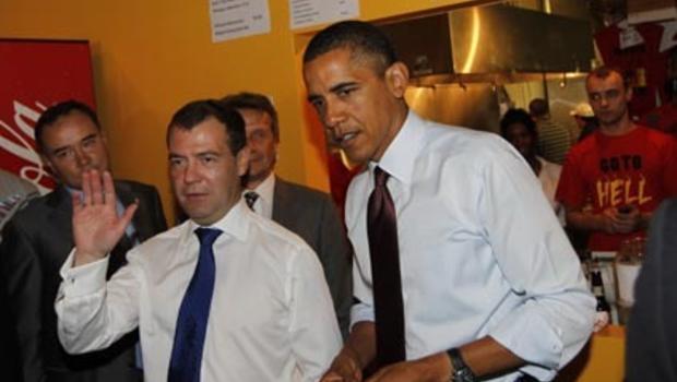 President Barack Obama and Russia's President Dmitry Medvedev make an ...
