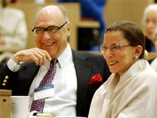 Supreme Court Justice Ruth Bader Ginsburg, right, laughs with her husband Martin Ginsburg