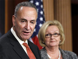 Sen. Charles Schumer, D-N.Y., left, and Sen. Claire McCaskill, D-Mo., talk about immigration and border security during a news conference in Washington, Aug. 5, 2010. The Senate has approved $600 million to beef up security at the U.S.-Mexico border.