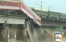 Train Dangles off Bridge