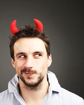 man in costume red horns