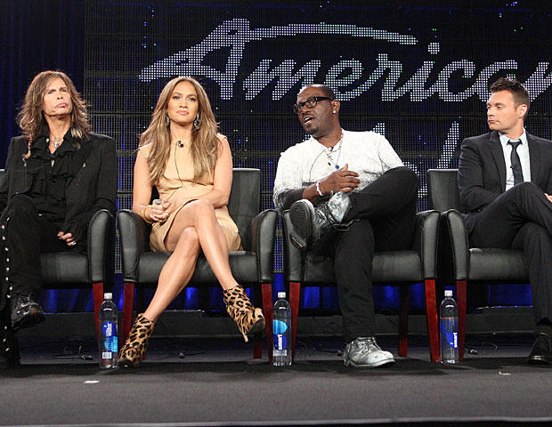 """""""American Idol"""" judges and host speak onstage during a panel at the FOX Broadcasting Company portion of the 2011 Winter TCA press tour held at the Langham Hotel on Jan. 11, 2011, in Pasadena, Calif. (Frederick M. Brown/Getty Images)"""