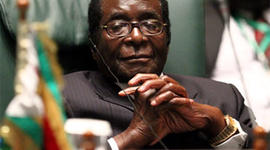 Robert Mugabe, President of the Republic of Zimbabwe, attends a joint Arab-African summit in the Libyan coastal city of Sirte on October 10, 2010. AFP PHOTO/KHALED DESOUKI (Photo credit should read KHALED DESOUKI/AFP/Getty Images)