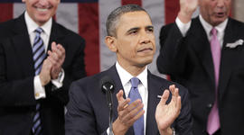 President Barack President Barack Obama is applauded by Vice President Joe Biden and House Speaker John Boehner of Ohio