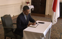 Obama signs condolence book at Japanese Embassy