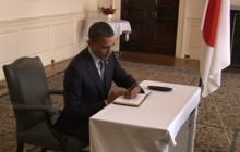 Obama signs condolence book at Japanese Embassy