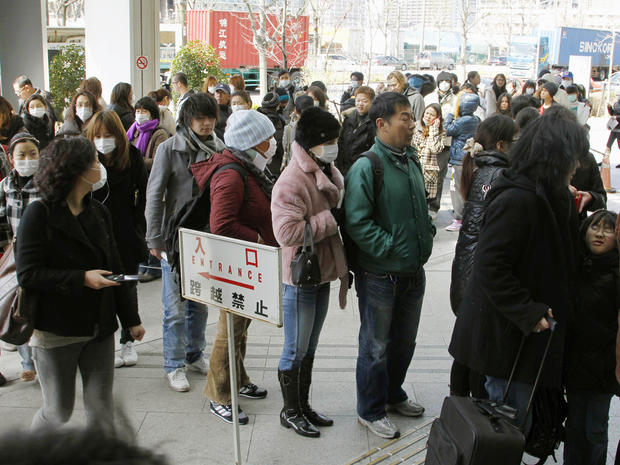 Foreigners wanted to flee line up for Japan re-entry permits