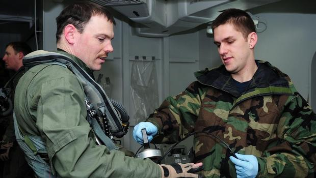 Navy personnel check radiations levels off the coast of Japan, March 18, 2011