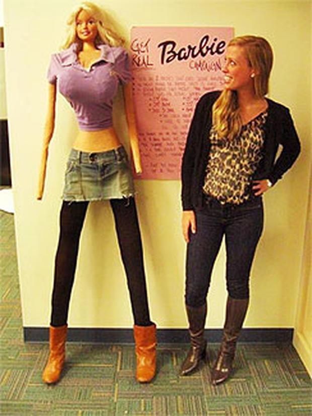 Galia Slayen stands with her life-sized Barbie
