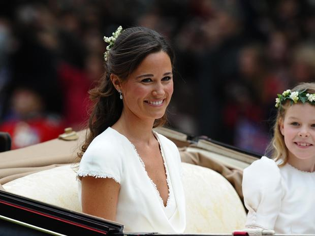 Maid of honour Philippa Middleton smiles as the travels in a Semi-State Landau in London after the wedding service for Britain's Prince William and Kate, Duchess of Cambridge, on April 29, 2011. AFP PHOTO / PAUL ELLIS (Photo credit should read PAUL ELLIS/AFP/Getty Images)