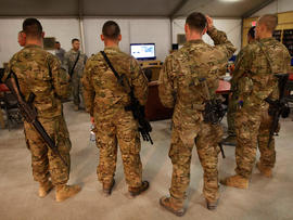 U.S. troops stationed at Kandahar Airfield, Afghanistan, watch breaking news on the announcement by President Barack Obama that Osama bin Laden had been killed.