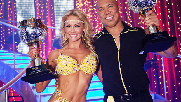 """Hines Ward and Kym Johnson pose with their trophies after they were named """"Dancing with the Stars"""" champions on May 24, 2011."""