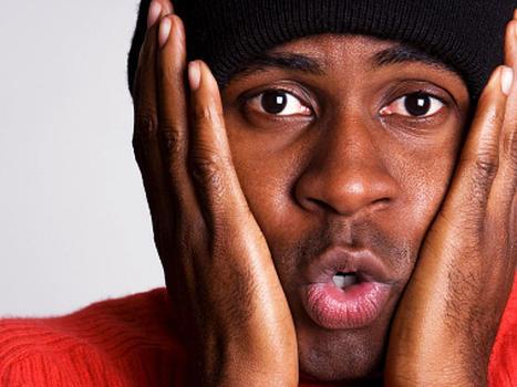 closeup, face, man, ski cap, facial expression, hands, cheeks, stock, 4x3