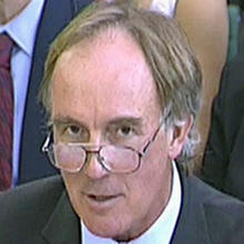 Tom Crone, legal manager of News International, gives evidence July 21, 2009, to a House of Commons committee in Westminster, London, in this image made from television. Crone, a senior lawyer who vetted News of the World stories for more than 20 years, left the newspaper's publisher July 13, 2011, as the phone hacking scandal continued to grow. Photo credit: AP Photo