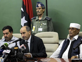 Mustafa Abdul-Jalil, center, the head of the interim government in Benghazi, delivers his statement to the press in the rebel-held town of Benghazi, Libya, July 28, 2011. Libya's rebel leadership council says its military commander has been killed. The National Transitional Council announced the death of Abdel-Fattah Younis July 28, 2011, hours after he was arrested by the rebels for questioning about suspicions his family still had ties to Muammar Qaddafi's regime.