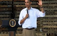 Obama takes swipe at GOP for signing pledges