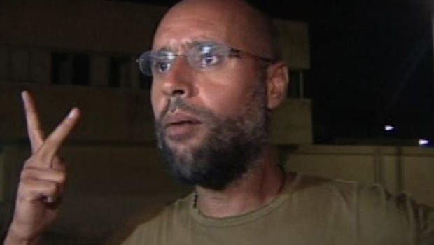 Qaddafi's son makes appearance after alleged arrest