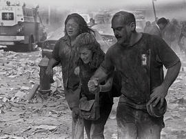 People walk through dust and debris from collapse of World Trade Center