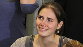 Amanda Knox is comforted by her sister, Deanna Knox, during a news conference shortly after her arrival at Seattle-Tacoma International Airport Oct. 4, 2011, in Seattle