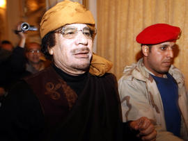 In this March 8, 2011, file photo, Libyan strongman Muammar Qaddafi arrives at the Rixos hotel in the capital of Tripoli.