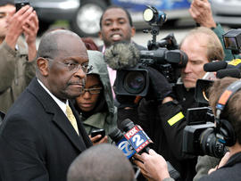 DETROIT, MI - OCTOBER 21: Republican presidential candidate Herman Cain speaks with the news media after unveiling his 'Opportunity Zone' economic plan in front of the Michigan Central Station, an abandoned train depot, October 21, 2011 in Detroit, Michigan. Cain has reportedly proposed changes to his '9-9-9' tax plan to exempt taxes for those living at or below the poverty line and businesses investing in 'Opportunity Zones'