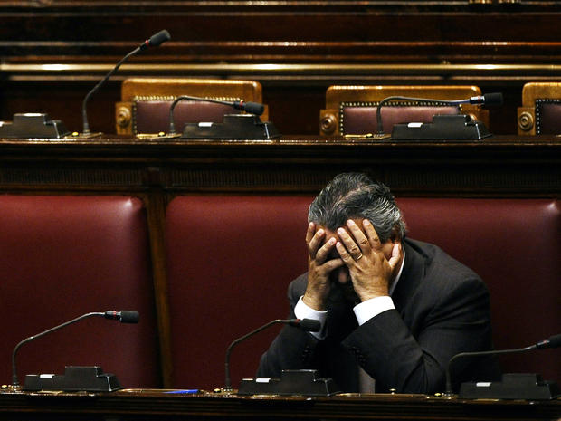 An unidentified deputy sits in an empty Italian Lower House before a debate to approve the last package of economic reforms in Rome Nov. 12, 2011.