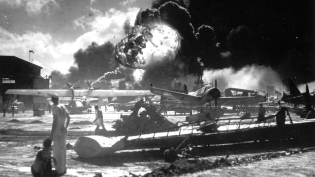 Sailors watch from Ford Island as the USS Shaw blows up in Pearl Harbor