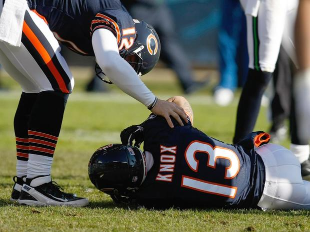 Johnny Knox lays on the field injured