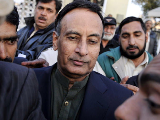 Pakistan's former ambassador to the United States, Husain Haqqani, center, exits the Supreme Court after meeting his lawyer in the secret memo scandal case in Islamabad Dec. 22, 2011.