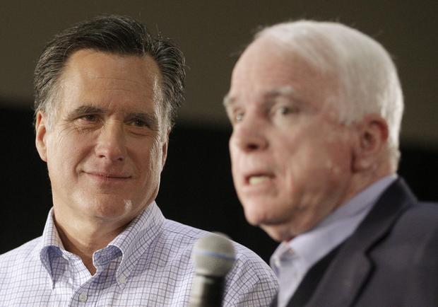 Mitt Romney listens at left, as Sen. John McCain speaks