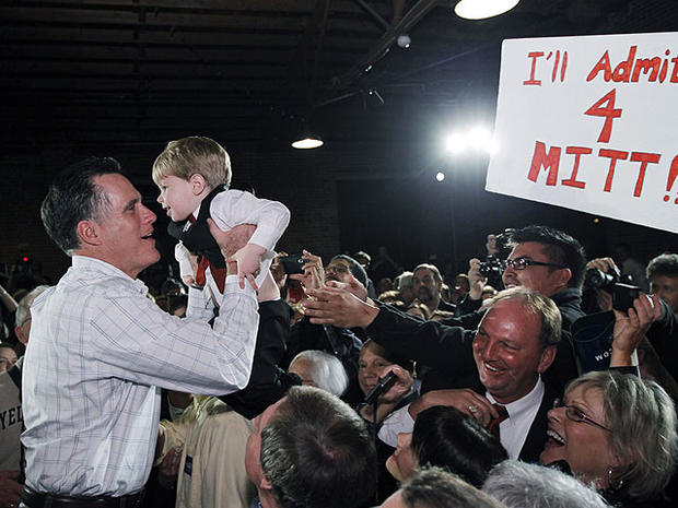 Republican presidential candidate, former Massachusetts Gov. Mitt Romney, picks up a child as he campaigns at The Hall at Senateâ??s End, in Columbia, S.C., Jan. 11, 2012.