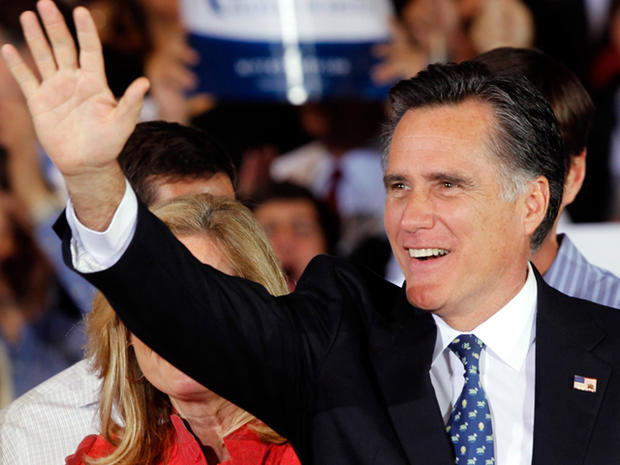Republican presidential candidate, former Massachusetts Gov. Mitt Romney waves to supporters during his victory celebration after winning the Florida primary election Tuesday Jan. 31, 2012, in Tampa, Fla