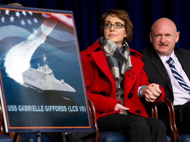 Former Arixona Rep. Gabrielle Giffords and her husband Mark Kelly, attend a ceremony at the Pentagon, Friday, Feb. 10, 2012, for the unveiling of the USS Gabrielle Giffords. The Navy has named a ship for Gabrielle Giffords, the recently retired congresswoman from Arizona who is recovering from a gunshot wound to the head received in January 2011.