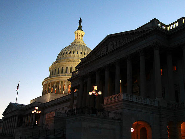 The U.S. Capitol is seen, Wednesday, Feb. 15, 2012, in Washington. Calling quits to a bruising election-year fight, negotiators on Capitol Hill worked into Wednesday night, ironing out final details of an agreement to extend a cut in the payroll taxes paid by most Americans.