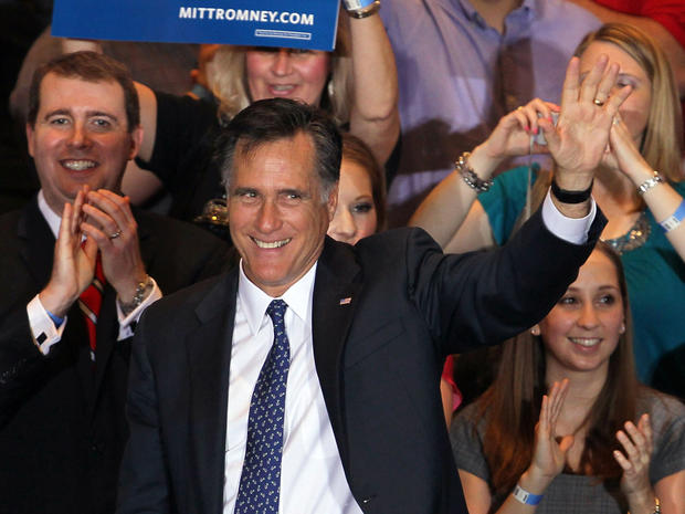 Mitt Romney greets supporters during an Illinois GOP primary victory party