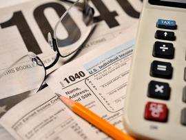 IRS Form 1040 and tax preparation materials