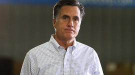 Mitt Romney pauses as he speaks during a town hall style meeting