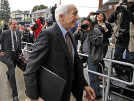 Former Penn State University assistant football coach Jerry Sandusky, center, arrives with his attorney Joe Amendola June 5, 2012, for the first day of jury selection at a courthouse in Bellefonte, Pa.