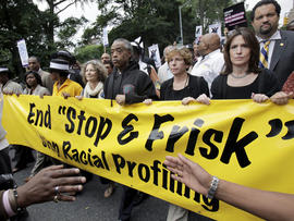 "The Rev. Al Sharpton, center, walks with demonstrators during a silent march to end the ""stop-and-frisk"" program in New York, on June 17, 2012."