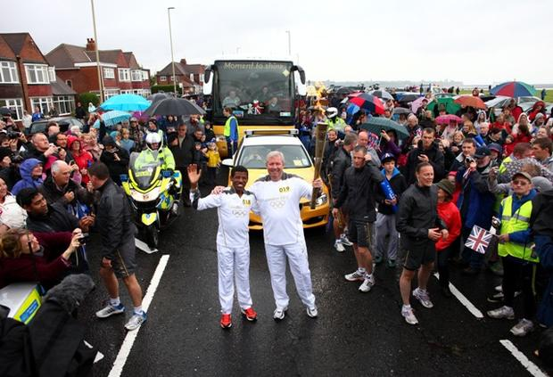 Olympic flame heads to London