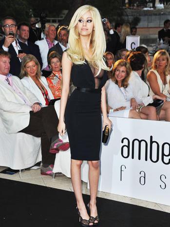 Ex-teen call girl's designs hit runway