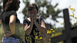 Relatives mourn Marina Lysenko, who died after floods in Krymsk, about 1,200 kilometers (750 miles) south of Moscow, Monday, July 9, 2012.