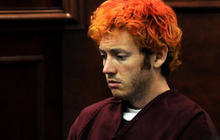 "Accused Colo. gunman ""must have practiced"" shooting"