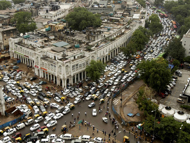 Streets are packed in heavy traffics following power outage and rains in the central part of New Delhi, India, Tuesday, July 31, 2012.