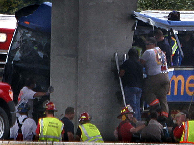 First responders work the scene of a Megabus crash on Interstate 55 near Litchfield, Ill., Aug. 2, 2012.