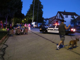 Police and residents near a home being searched after the Wisconsin Sikh temple shooting