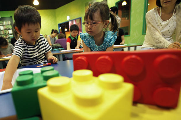 Kids build Lego masterpiece